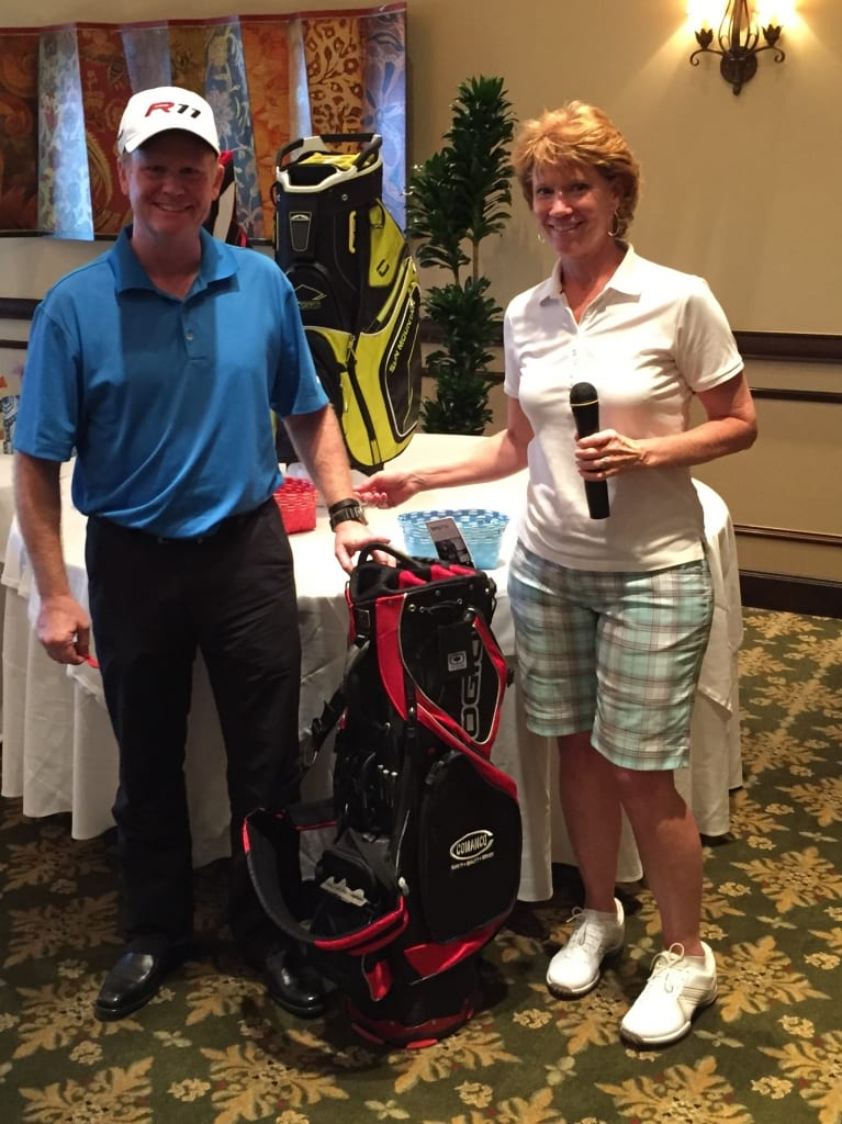 Winner:  Mike Getz, FCI Residential Corp. with Event Organizer Denise Palmatier, SFWMD
