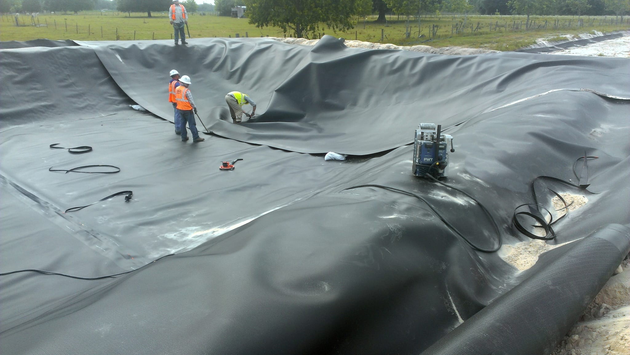 Comanco successfully installs pond liner comanco for Pond liner installation