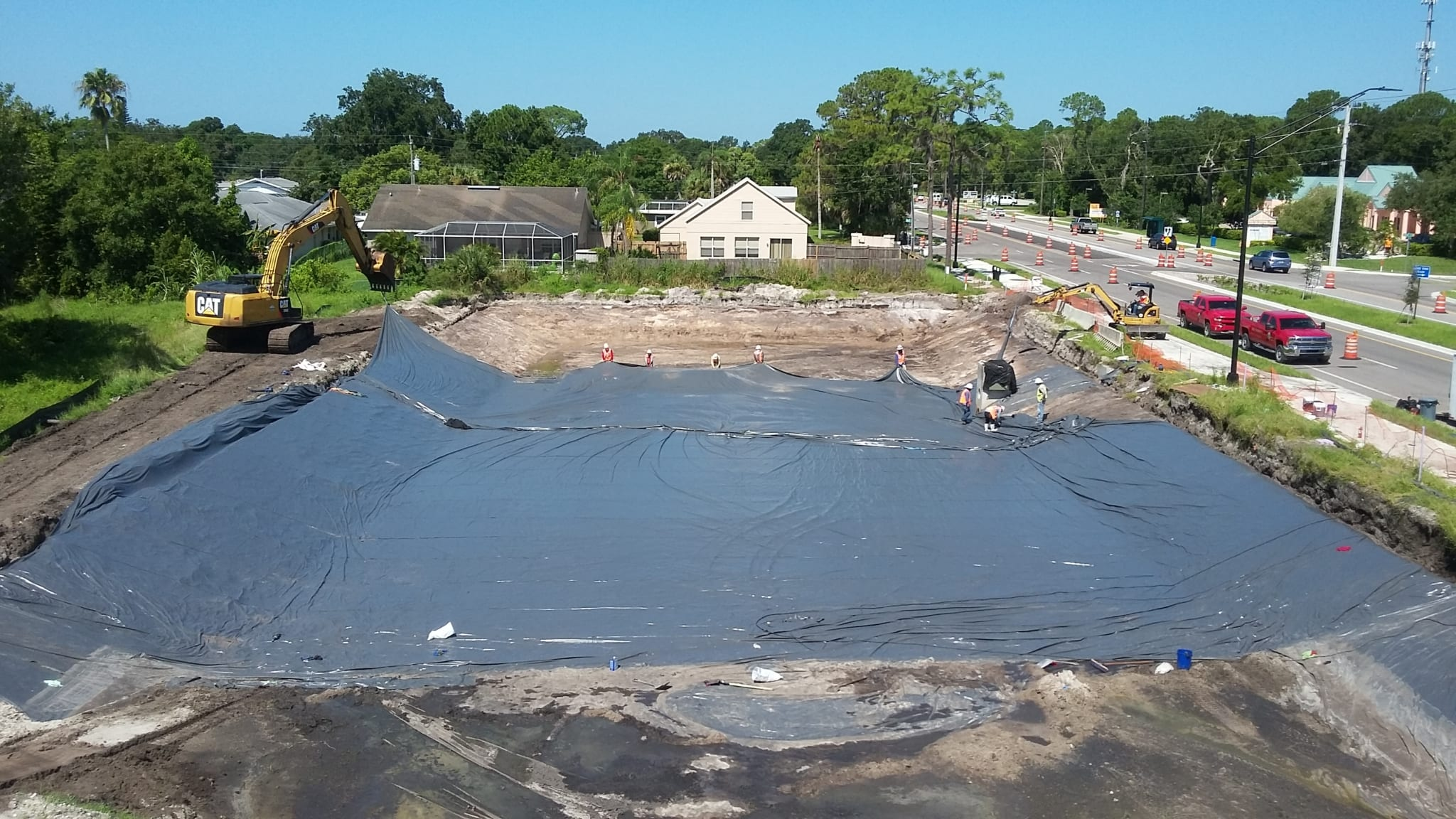Comanco completes pvc liner installation comanco for Pond liner installation